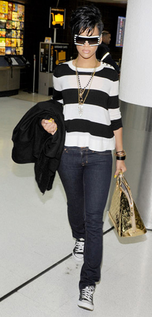 Rihanna arrives at Miami International Airport on December 13, 2